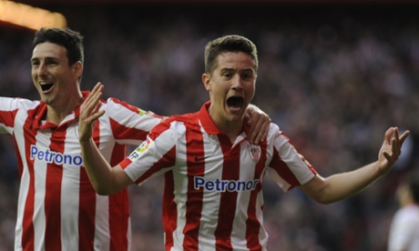 Athletic Bilbao's midfielder Ander Herrera (R) celebrates with Athletic Bilbao's forward Aritz Aduriz (L) after scoring during the Spanish league football match Athletic Club Bilbao vs Sevilla FC at the San Mames stadium in Bilbao on April 27, 2014.  AFP PHOTO / RAFA RIVASRAFA RIVAS/AFP/Getty Images