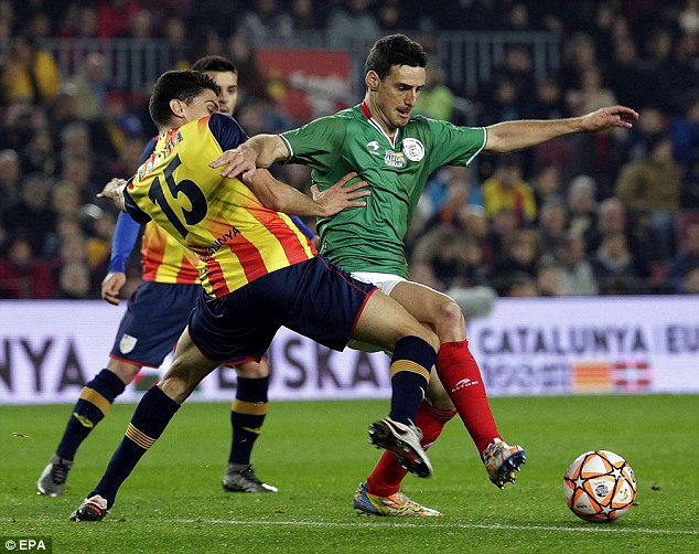 ©EPA| Aduriz represented the Basque Country against Catalonia on Boxing Day, here battling Marc Bartra