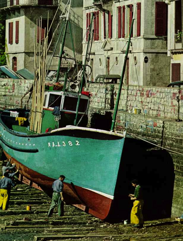 Boats are repaired in the harbor of St. Jean-de-Luz, France