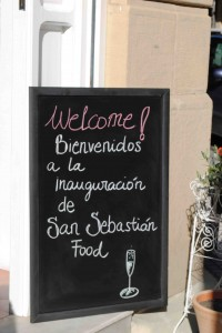 Welcome chalk board as guests arrive for the opening